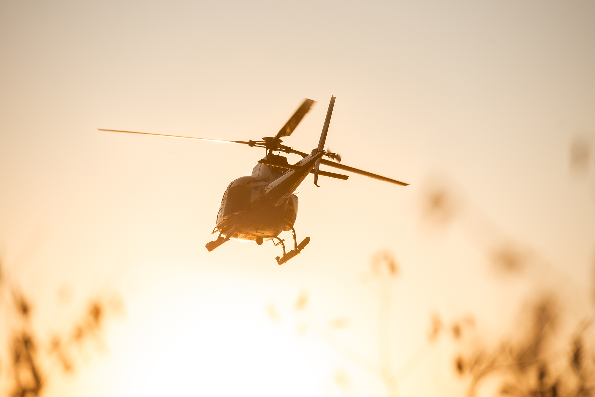 Passanger Helicopter flying in sunset sky